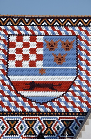 homily: Coat of arms checkered tiled rooftop of St Marks church in Zagreb, Croatia