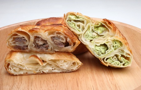 Burek (pie with meat, cheese or spinach) is traditional Balkanian meal photo
