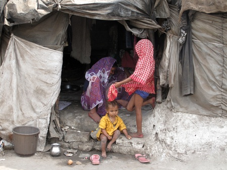 shack: KOLKATA, INDIA -JANUARY 25: Streets of Kolkata. Poor Indian family living in a makeshift shack by the side of the road , January 25, 2009.                           Editorial
