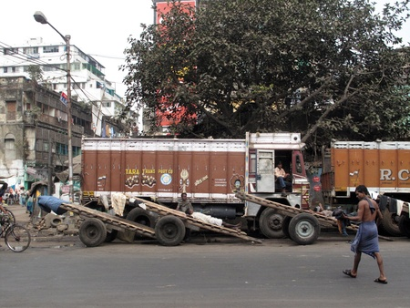 KOLKATA, INDIA -JANUARY 25: Streets of Kolkata. Trucks and carts wait for customers to transport their cargo, January 25, 2009.                               Stock Photo - 10581031