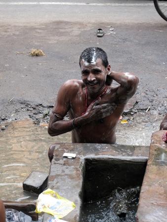 KOLKATA, INDIA -JANUARY 25: Streets of Kolkata. Indian people wash themselves on a street , January 25, 2009. Stock Photo - 10581009