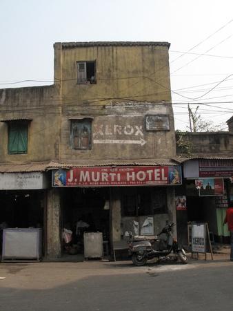 cheap: KOLKATA, INDIA -JANUARY 23: Streets of Kolkata. J. Murti Hotel, January 23, 2009.