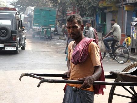KOLKATA, INDIA -JANUARY 25: Streets of Kolkata. Portrait of a rickshaw driver, January 25, 2009. Stock Photo - 10604425