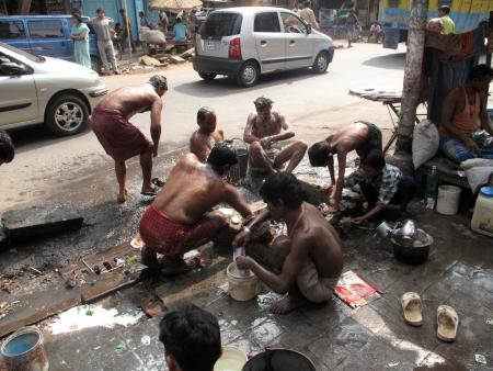 KOLKATA, INDIA -JANUARY 25: Streets of Kolkata. Indian people wash themselves on a street , January 25, 2009. Stock Photo - 10581027