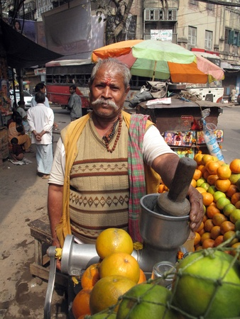 KOLKATA - JANUARY 25: Mobile stall selling fruit juice on the street on January 25, 2009 in Kolkata, India. Many Indians eat from fresh food stalls on the street rather than eating at home.