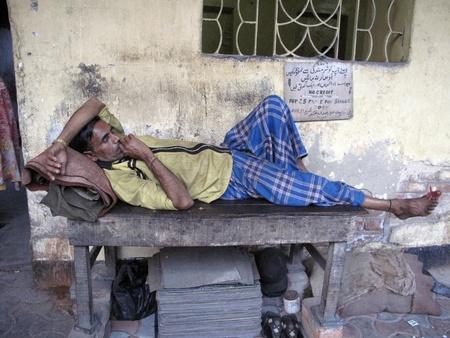 old beggar: KOLKATA, INDIA - JANUARY 25: Streets of Kolkata, man sleeping on the streets of Kolkata,India on January 25, 2009.