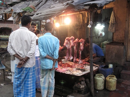unhygienic: KOLKATA, INDIA -JANUARY 25: Streets of Kolkata. Butcher and his stall at the market in India where hygiene is very poor, January 25, 2009.