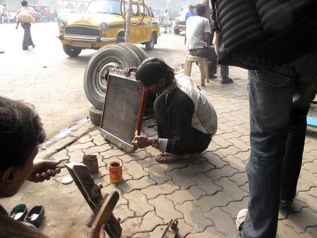KOLKATA, INDIA - JANUARY 27: Streets of Kolkata, mechanic at workshop on January 27, 2009 in Kolkata, West Bengal, India.                                Stock Photo - 10666506