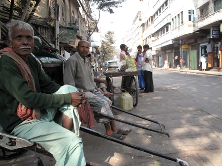 KOLKATA, INDIA - JANUARY 30: Men wait for passengers on their rickshaw during economically difficult time January 30,2009 in Kolkata, India.                               Stock Photo - 10650321