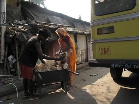 the unskilled worker: KOLKATA, INDIA - JANUARY 30: Streets of Kolkata, Street cleaner on January 30, 2009 in Kolkata, West Bengal, India.                                Editorial