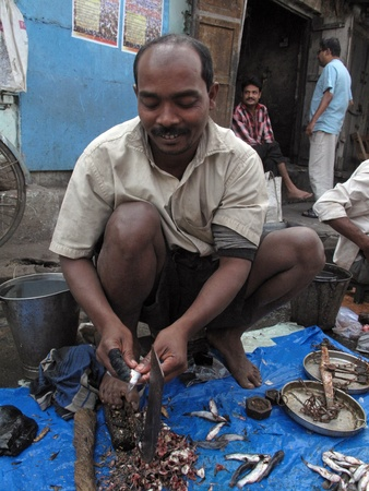 KOLKATA, INDIA - FEBRUARY 01: Unknown man selling fish at a street market on February 01, 2009 in the Chowringhee area of Kolkata, West Bengal, India