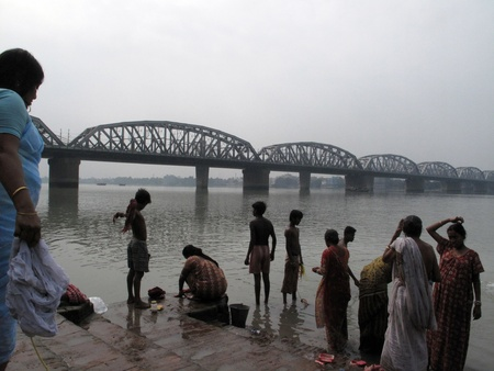hooghly: CALCUTTA - FEBRUARY 02 2009: Morning ritual on the Hoogly(Ganges) river on February 02, 2009. At present time this river is being polluted tremendously.                                Editorial