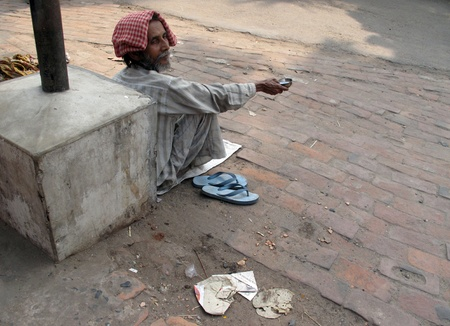mendicant:  KOLKATA, INDIA -FEBRUARY 02: Streets of Kolkata. Thousands of beggars are the most disadvantaged castes living in the streets, February 02, 2009.