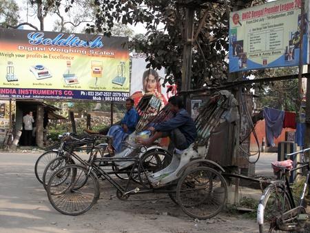KOLKATA, INDIA - FEBRUARY 02: Men wait for passengers on their rickshaw during economically difficult time February 02,2009 in Kolkata, India.                                Stock Photo - 10581062