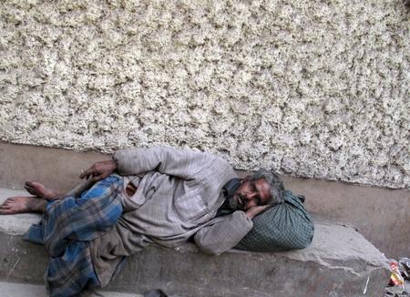 old beggar: KOLKATA, INDIA - FEBRUARY 03: Streets of Kolkata, man sleeping on the streets of Kolkata,India on February 03, 2009.