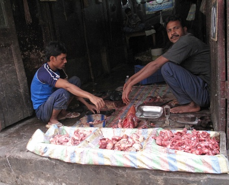 KOLKATA, INDIA - FEBRUARY 03: Streets of Kolkata. Butcher and his stall at the market in India where hygiene is very poor, February 03, 2009.  in Kolkata, India Stock Photo - 10781138