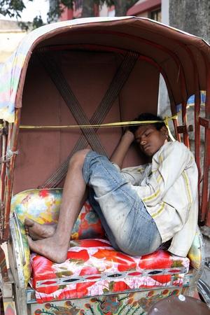 KOLKATA, INDIA - FEBRUARY 01: Men wait for passengers on their rickshaw during economically difficult time February 01,2009 in Kolkata, India. Stock Photo - 10693853