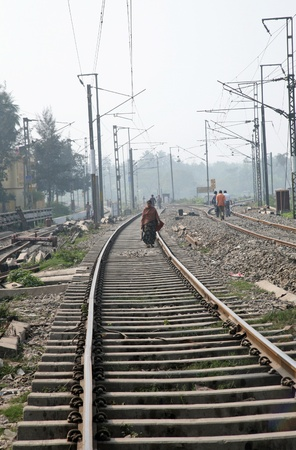 BARUIPUR, INDIA - JANUARY 13: A woman walking on the railroad, India has one of the most developed rail network in the world, Baruipur West Bengal on January 13, 2009.