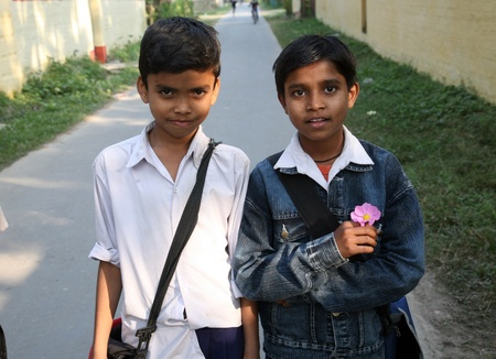 poverty india: SONAKHALI, INDIA - JANUARY 13: two friends going to school  on January 13, 2009. Sonakhali, West Bengal, India. Education has been made free for children for 6 to 14 years of age in India.