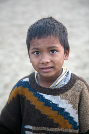 estimated: KUMROKHALI, INDIA - JANUARY 14: Portrait of boy on street on January 14, 2009 in Kumrokhali, West Bengal, India. UNHCHR has estimated that India has the largest population of street children in the world.