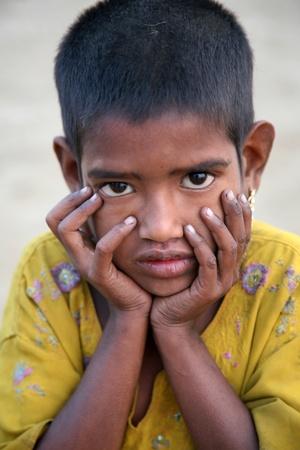 estimated: KUMROKHALI, INDIA - JANUARY 14: Portrait of girl on street on January 14, 2009 in Kumrokhali, West Bengal, India. UNHCHR has estimated that India has the largest population of street children in the world.
