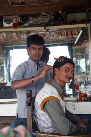 SONAKHALI, INDIA - JANUARY 17: Hair cutting in an indians salon on January 17, 2009 in Sonakhali, West Bengal, India.