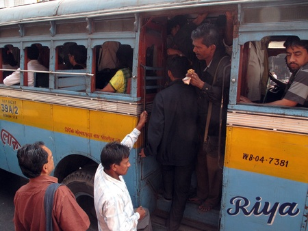 calcutta: KOLKATA, INDIA - JANUARY 28: A group of people entering the bus in Kolkata on January 28, 2009. Unsatisfactory quantity & quality of public transportation limit indian people in everyday traveling.