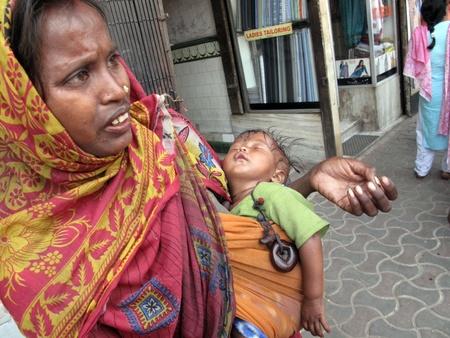 disadvantaged: KOLKATA, INDIA -JANUARY 28: Streets of Kolkata. Thousands of beggars are the most disadvantaged castes living in the streets, 42% of India falls below the international poverty line of $1.25 a day. Kolkata, India on January 28, 2009.