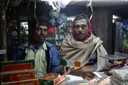 BARUIPUR, INDIA - JANUARY 13: Portrait of the traders in the shop in Baruipur, West Bengal, India January 13, 2009.