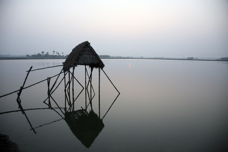 modest: Modest straw hut of Indian fishermen in the Ganges, Sunderband, West Bengal, India Stock Photo
