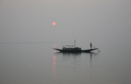 holiest: A stunning sunset looking over the holiest of rivers in India. Ganges delta in sunderbands, West Bengal, India Stock Photo