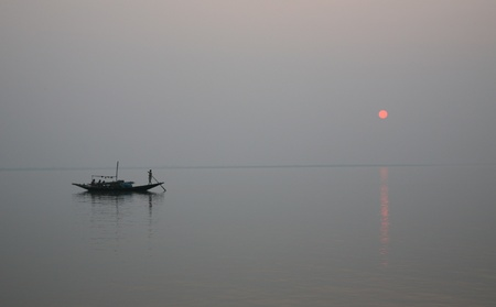 A stunning sunset looking over the holiest of rivers in India. Ganges delta in sunderbands, West Bengal, India Stock Photo - 11105791