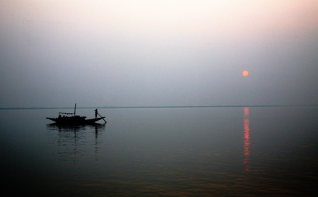 A stunning sunset looking over the holiest of rivers in India. Ganges delta in sunderbands, West Bengal, India photo