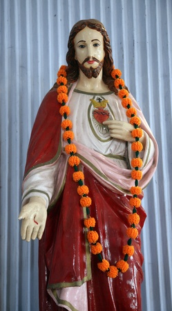 sacred heart: BASANTI, INDIA - JANUARY 17: Sacred Heart of Jesus. The Catholic Church in Basanti, West Bengal, India January 17, 2009. There are over 17.3 million Catholics in India which represents less than 2% of the total population. Stock Photo
