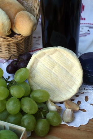Wine, cheese and grapes photo