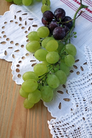 Grape cluster on a white tablecloth photo