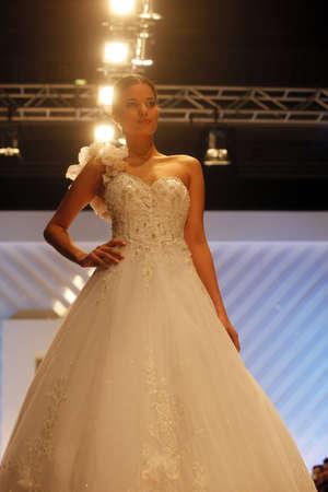 ZAGREB, CROATIA - FEBRUARY 19: Fashion model walks the runway in wedding dress on  Stock Photo - 12287637
