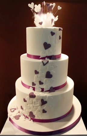 Delicious funny decorated wedding cake photo