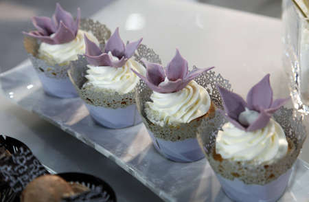 Colorful desserts and pastry served on a wedding party photo