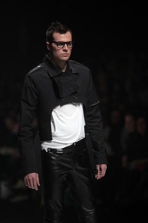 ZAGREB, CROATIA - MARCH 16: Fashion model wears clothes made by Link by Ogi Antunac and Zoran Mrvoš on
