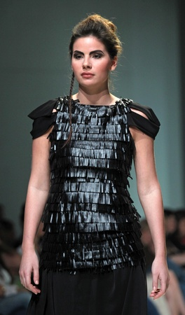 ZAGREB, CROATIA - May 11: Fashion model wears clothes made by Ivancica Hrustic on ZAGREB FASHION WEEK show on May 11, 2012 in Zagreb, Croatia.