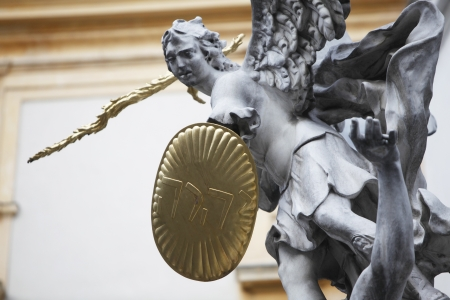 Statue of Saint Michael with gold shield and sword in center of Vienna, Austria photo