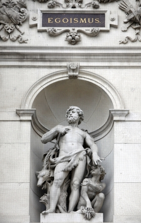 allegory: Burgtheater, Vienna, statue shows an allegory of egoism Stock Photo