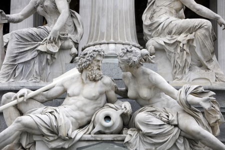 greek gods: Detail of Pallas-Athene fountain in front of Austrian parliament, Vienna, Austria  Sculptures represent rivers Danube and Inn Stock Photo