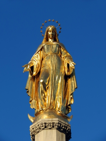 Virgin Mary statue made of gold photo