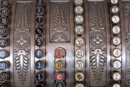 Antique store silver cash register buttons photo