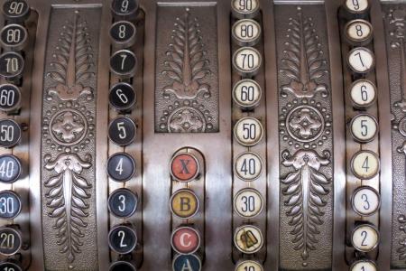Antique store silver cash register buttons photo