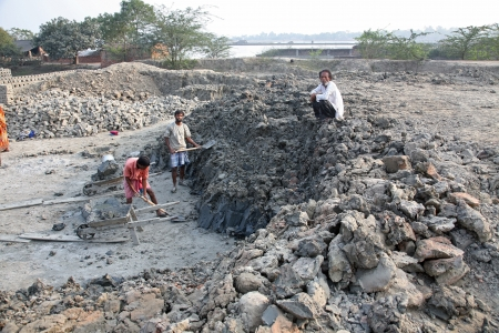 third world economy: SARBERIA,INDIA, JANUARY 14: Brick field. Laborers are carrying deposited soil for making raw brick. on January 14, 2009 in Sarberia, West Bengal, India.