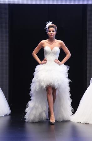 strapless: ZAGREB, CROATIA - OCTOBER 27: Fashion model wears wedding dress made by Royal Bride on Wedding days show, October 27, 2012 in Zagreb, Croatia. Editorial