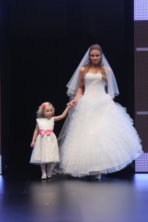 strapless: ZAGREB, CROATIA - OCTOBER 27: Fashion model wears wedding dress made by Nancy on Wedding days show, October 27, 2012 in Zagreb, Croatia.